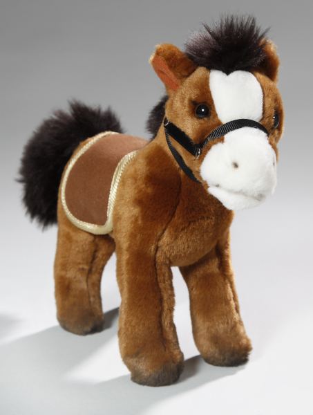 Horse standing red-brown with saddle