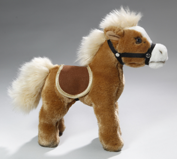 Horse standing beige with saddle